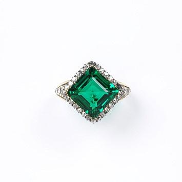 Square emerald set within a border of 24 brilliant-cut diamonds c. 1850.