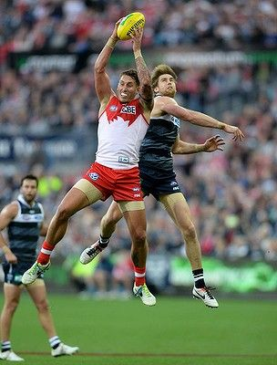 Jesse White (Sydney Swans) out-marks Tom Lonergan (Geelong Cats). And people think only basketball players get air-borne!