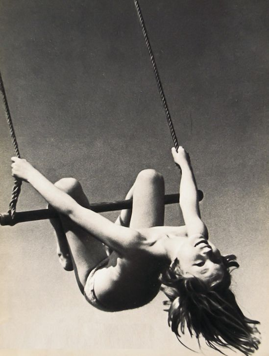 Andre Steiner- Topless female swinging on trapeze, 1935