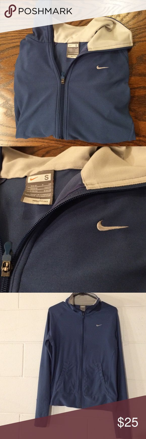 Women's Nike FIT DRY zip-up jacket. In excellent, like new condition. I LOVE this blue color. White Nike logo on chest. Complete zip up in front. Has the same stretchy Nike FIT DRY fabric. 2 pockets in front for hands. 92% polyester, 8% spandex. Fits great and looks super cute!! Nike Jackets & Coats