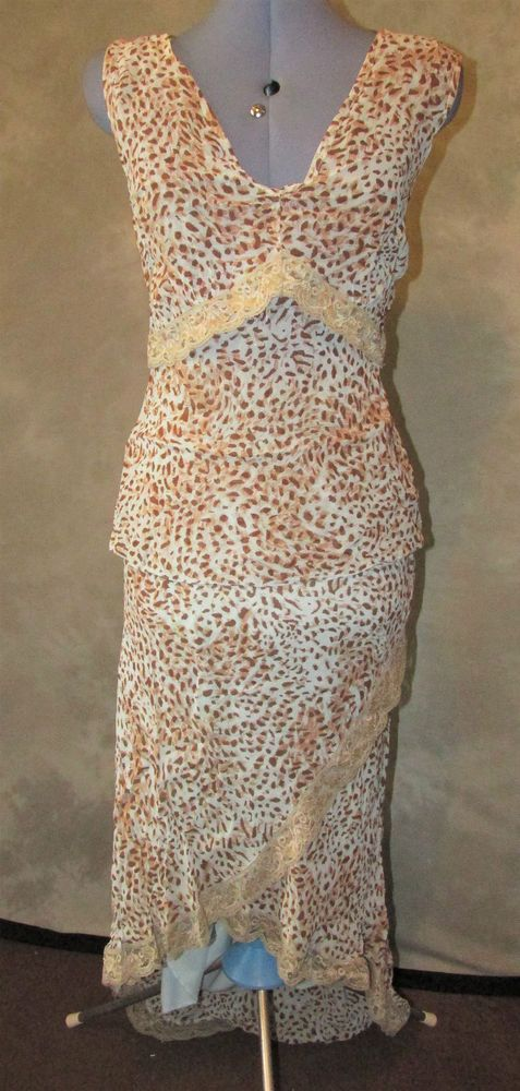 Fashion Extra,ladies,size 16,animal print,v neck,sleeveless,formal,Skirt Suit.