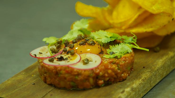 Carne apache is a Mexican-style beef tartare, similar to ceviche in that it uses lime to cure and season the beef.