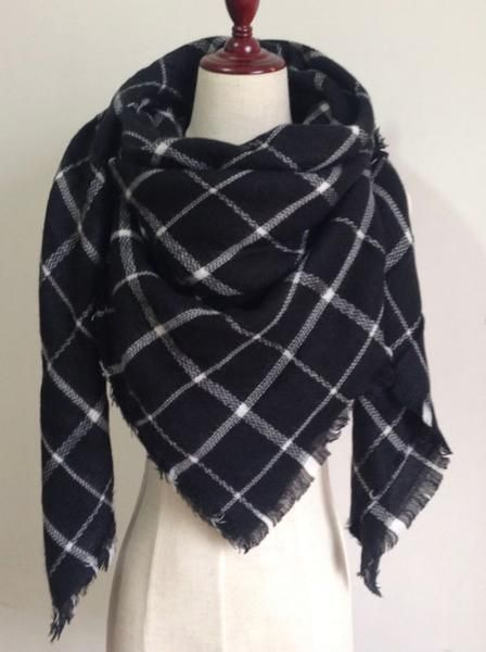 This extra soft scarf is perfect to keep you warm and stylish the whole water and fall season. This scarf is plaid with black, and white. Size: 55 inches by 55 inches
