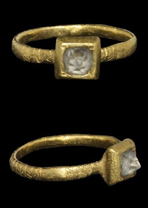 Medieval Gold Ring with Crystal 14th-15th century AD . A decorated finger ring with flat-section hoop decorated with panels of incised chevrons, square bezel with inset conical facetted crystal.