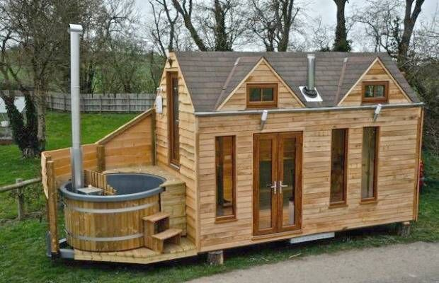 This cabin by an English company called Tiny Wood Homes has an unusual finishing touch that brings an extra bit of comfort to the tiny house lifestyle — a petite, personal hot tub.