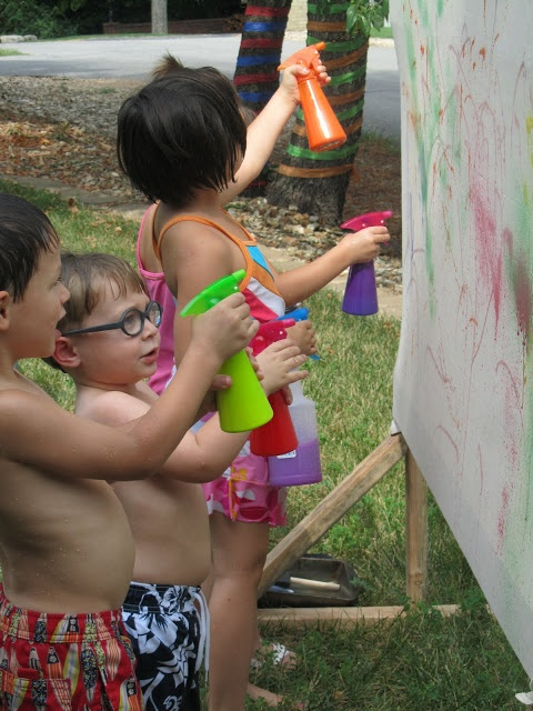 Play Create Explore: Messy Art/ Rainbow Theme Outdoor Birthday Party; this kind of makes me wish my girls had spring/summer birthdays. I'll find a way to take this indoors....
