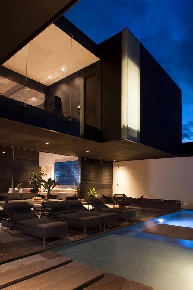 Laze by the pool in this modern luxurious villa. Do you like the dark hues?