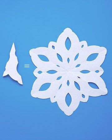 Gently unfold the paper to see your unique snowflake. Use poster putty to attach to windowpanes, or make a wreath of snowflakes by sticking them one at a time to a wall with poster putty.