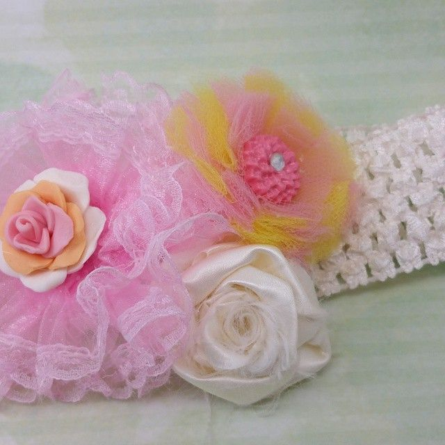 This beautiful headband has 3 handmade flowers. This is a lovely addition for Women or children. The headband is crocheted elastic that is very stretchy. This will fit most babies all the way through adult sizes.