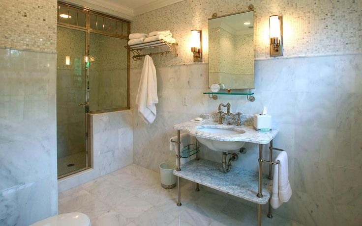 Hemingway Construction | Gallery of Bathrooms | Traditional Bathroom | Carrera Marble | 1900s Vanity | Tile Laid Square