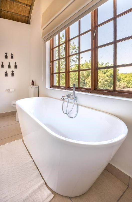 Bath in an exclusive country home and cottage set in a beautiful river valley on a subtropical fruit and nut farm near Nelspruit, #Mpumalanga #southafrica #bathtub