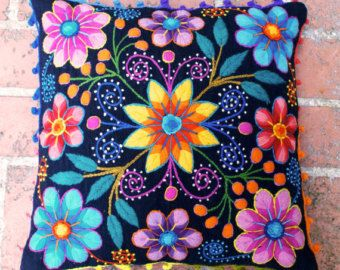 Vibrant, colorfull flowers pop beautifully from the black background of this hand embroidered cushions. Fantastic textures of needlework from the Andes to your home. The pilllows are first woven on a traditional loom with sheep wool and later adorned with hand embroidered flowers made of alpaca wool. A playful crochet trim gives this cushions the perfect finish.  Back zipper clousure. Measures 16 in x 16 in Color Black  2 pillow covers included . No inserts or fillers included  Please note…