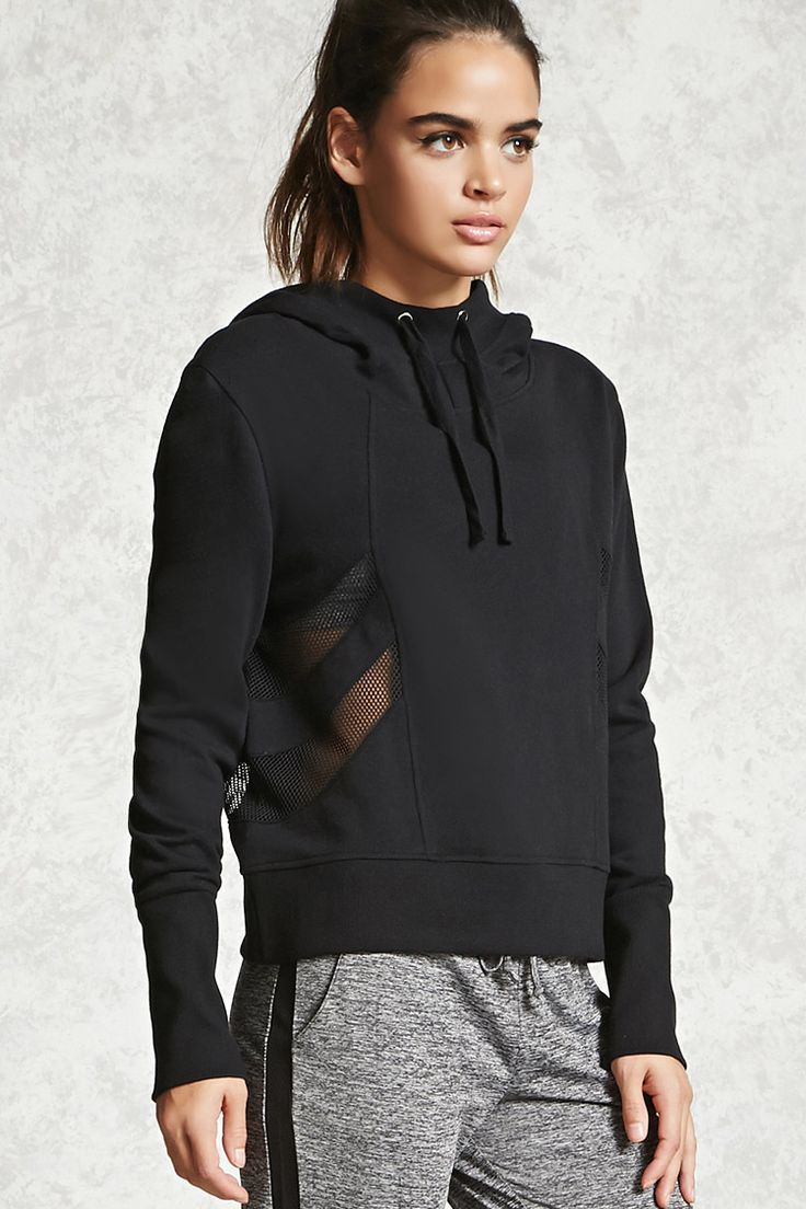 An athletic fleece knit hoodie featuring side mesh panels, long sleeves, and ribbed trim.