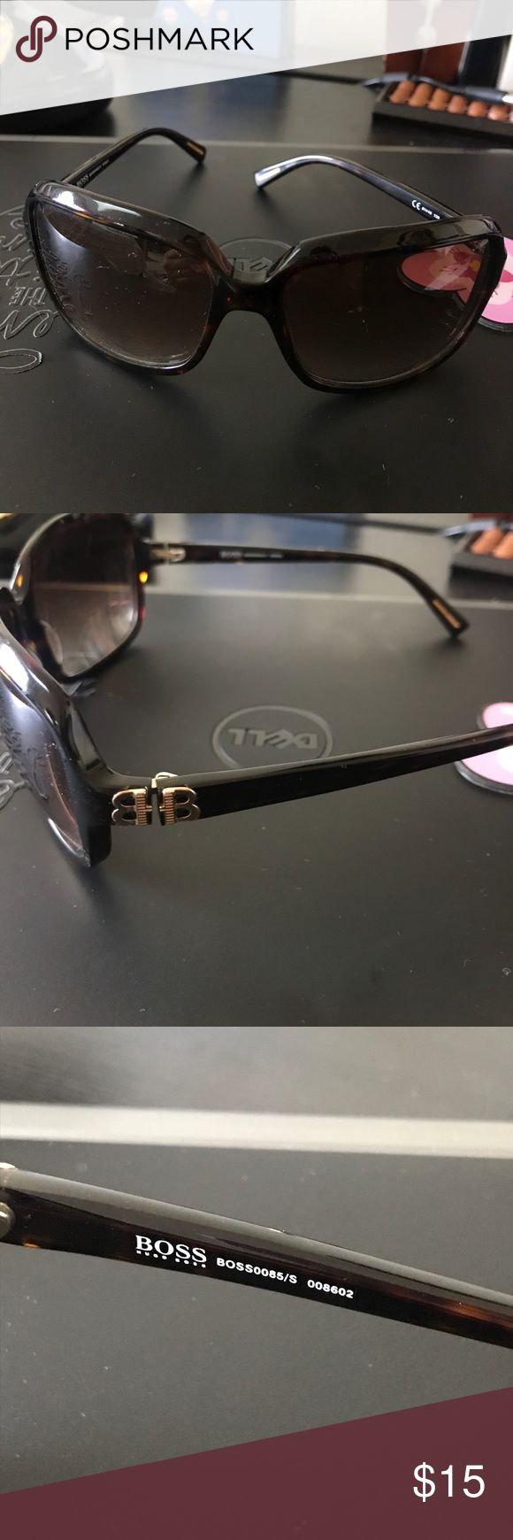 Boss Hugo Boss sunglasses Boss by Hugo Boss square brown sunglasses. These sunglasses show some scratches throughout. Hugo Boss Accessories Sunglasses