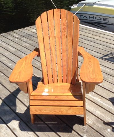 Good morning. I purchased your folding adirondack chair plans a few years ago and just refinished them. They look great again. The wood is black locust, hard as nails to work with and heavy but won't blow off the dock. Starts off a bit yellowy but quickly warms up nicely. Photo attached of my refinished chair. Thanks  Ray