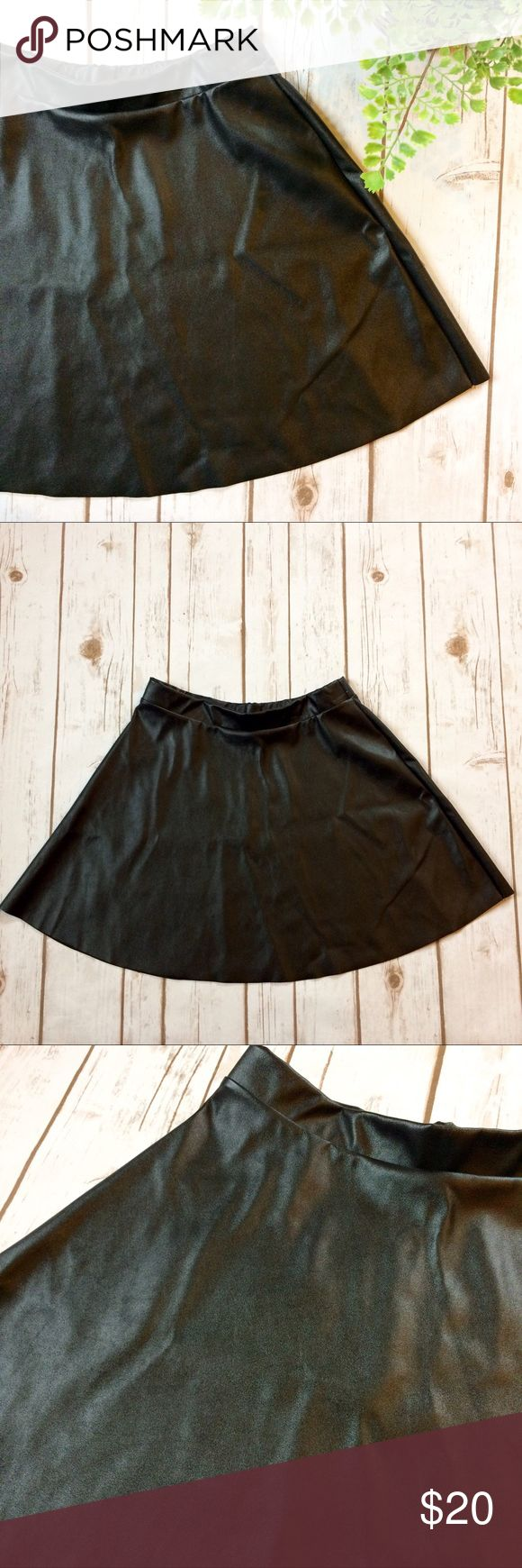 "Faux Leather Circle A Line Skirt Super cute and trendy for spring! Pair with booties, wedges, or sandals to dress up or down. Elastic waistband with faux leather fabric flowing down. Waist: 26"" - 30"" Length: 15.5"" Fabric Content: 100% Polyester Peach Royal Skirts Mini"
