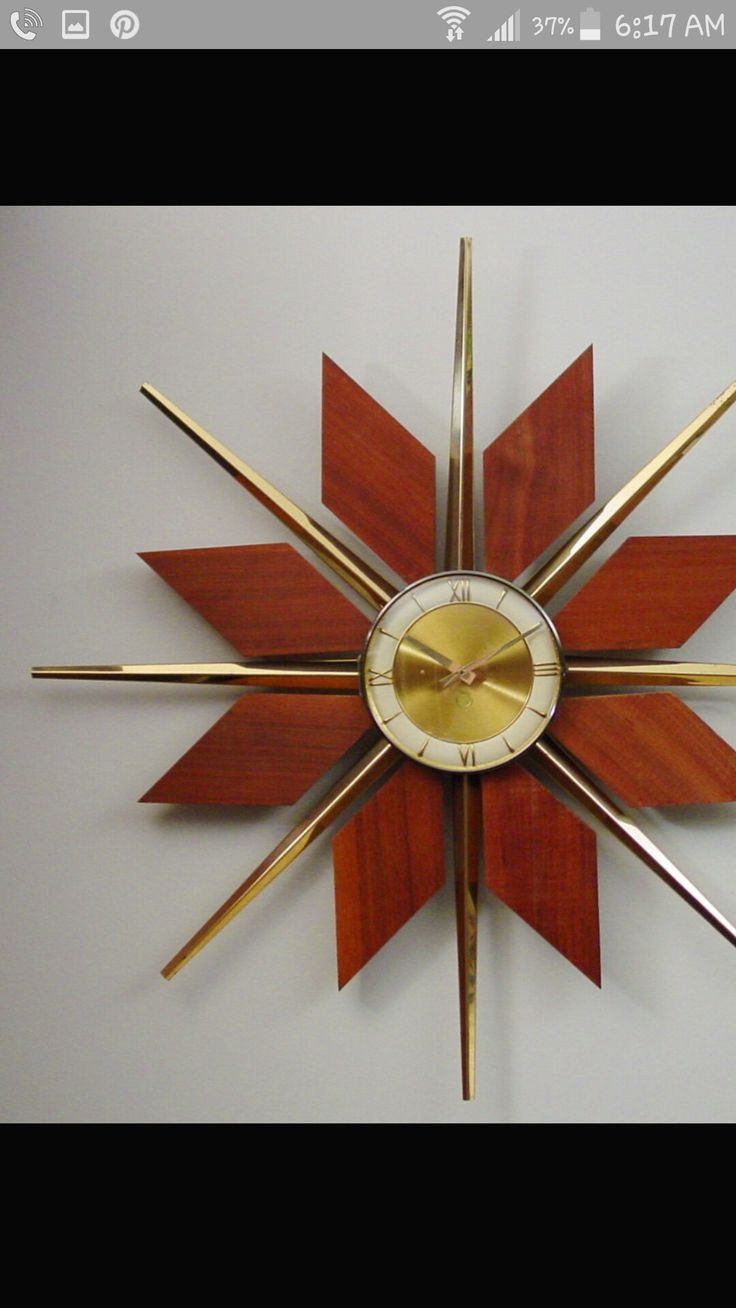 best atomic crazy images on pinterest  - another floralpatterned wall clock with wooden petals and brass stamen