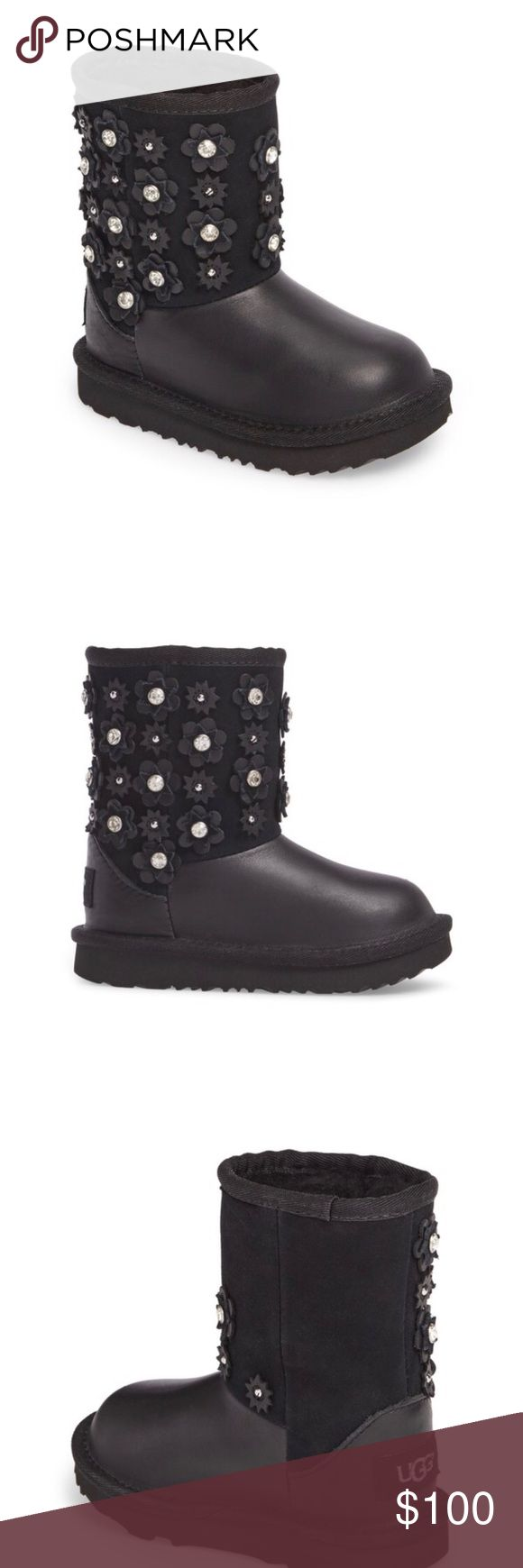 UGG K Classic Short II Petal Size 5M Big Kid K Classic Short II Petal 1019818k Black Size 5 M Big Kid. I wear between 5.5-6 women and these cute booties fits me, super comfortable. Retail for $139.95. Great for your girls too with this cute flower/ petal designs. MAke me an offer. Comes with box. Authentic. Got it at Nordstrom UGG Shoes Rain & Snow Boots