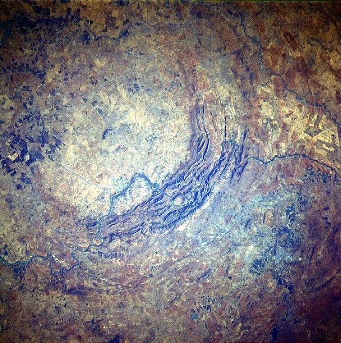 Possibly the oldest and largest asteroid impact crater on earth. Fascinating. I wish I could visit them all!