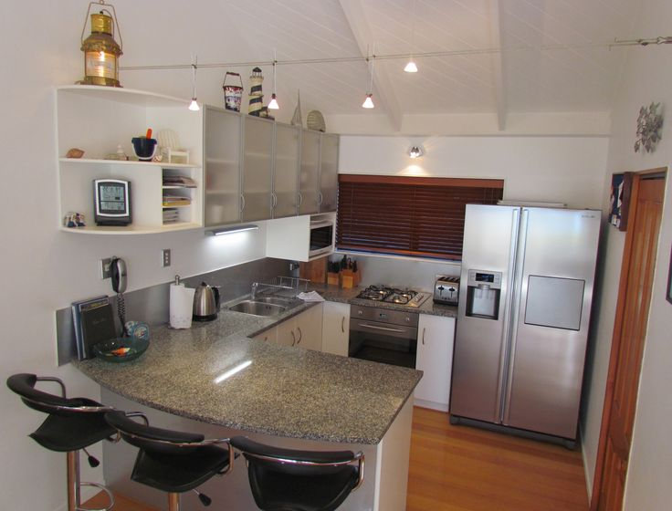 Fully equipped granite kitchen with dual dish drawer dishwashers, ice maker, gas hobs