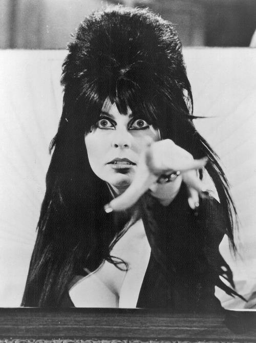 cryptofwrestling:  Elvira throwing a whammy… (1980s)