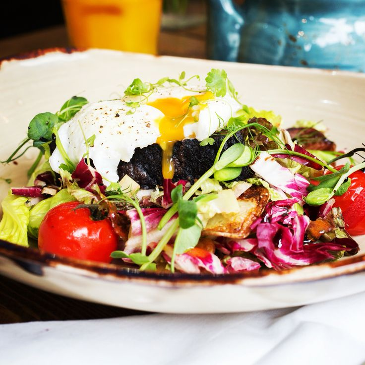 Warm Breakfast Salad.. Sauté Potatoes, Black Pudding, Grilled Cherry Tomatoes and a Poached Egg..