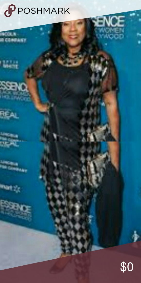 Help me find this, please!! Worn by Loretta Devine at the Black Women in Hollywood awards, Feb 2017. She looks fabulous in this! I've tried different searches and get pics of her but no info about the designer or where to find it. I am obssessed with this outfit!   If anyone knows or has a way to find out, please let me know? Thanks! Pants Ankle & Cropped