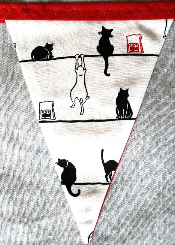 Kitty Cat Bunting Flags in red, white & black. £10.00, via Etsy.