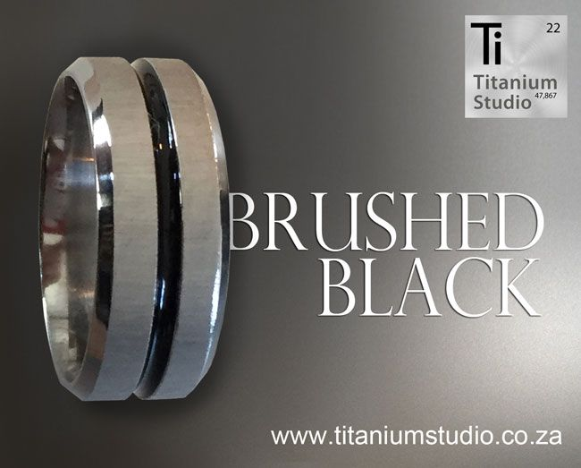 Titanium and black ring with a brushed metal finish and recessed black resin inlay.