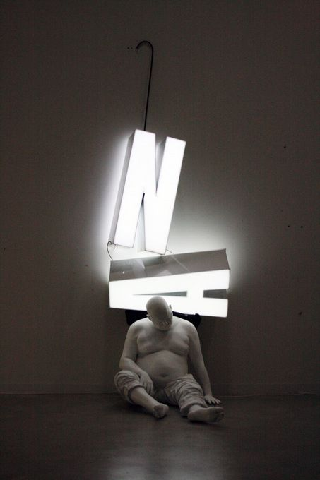 Bernardí Roig - Last dream, 2008.  Polyester resin, luminous aluminium lettering, life-size figure. Light art installation.
