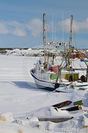 Ice in the harbor, the fishing boats are unable to move until the ice melts in spring