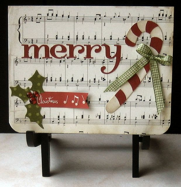 """Cute """"Merry"""" Card...with sheet music paper & candy cane embellishment.  Picture only for inspiration."""