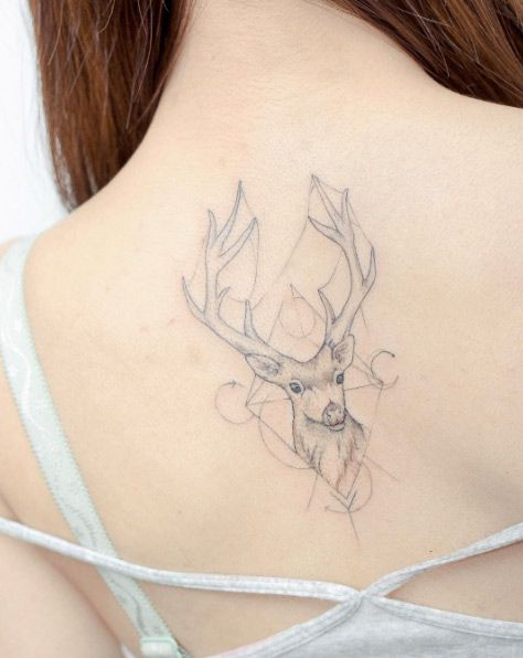 Dr. Woo-influenced stag tattoo by Hello Tattoo