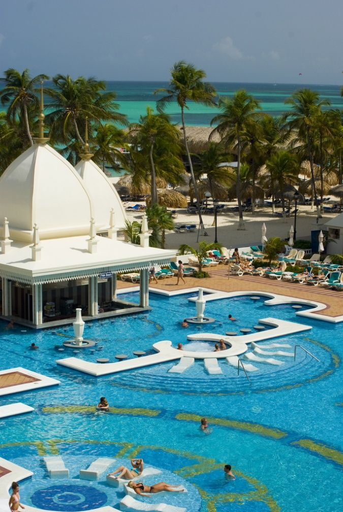 RUI Palace Aruba - All-inclusive resort featuring 5 restaurants, 5 bars including one swim-up , 24-hour room service, 2 pools, etc.  ASPEN CREEK TRAVEL - karen@aspencreektravel.com