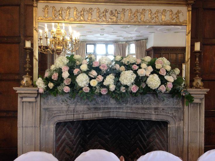 Mantelpiece decoration using Roses, Hydrangeas and Foliage