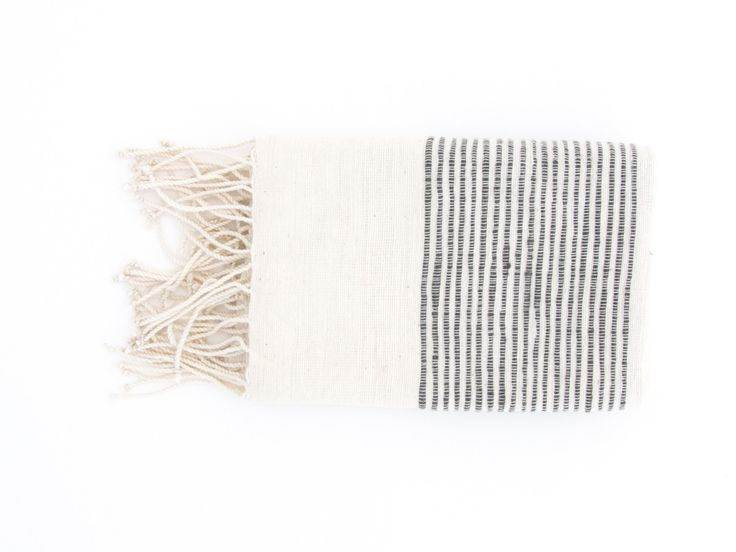 """By Creative Women Soft, natural hand towels with ribbed ends are a classic complement to any style. Hand-spun cotton, handwoven in Ethiopia. 21""""x 27""""100% cotton. Machine wash, tumble dry low. Do not use bleach or fabric softener."""