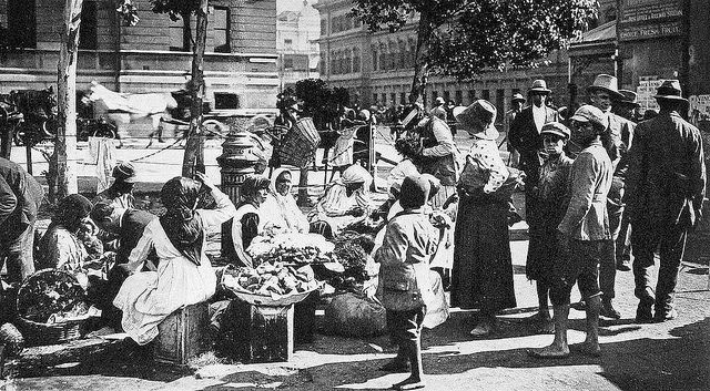 The curious mingling of races in Capetown gives the city a tone unlike that of any city in the world. Fruit Vendors in Cape Town 1898