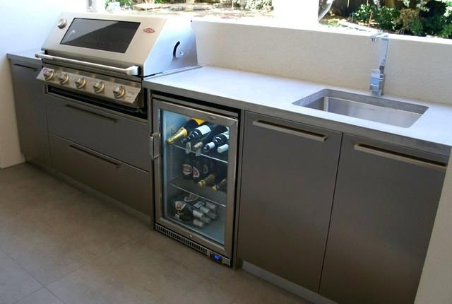 Stainless Steel Outdoor Kitchen With A Polished Concrete Doors Industrial Patio Sink Cabi Outdoor Kitchen Cabinets Kitchen Design Styles Outdoor Kitchen Design
