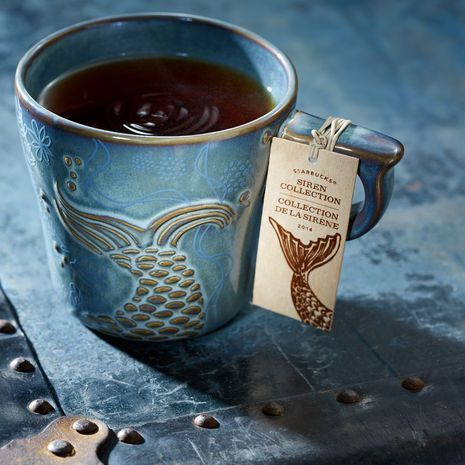 Anniversary Siren's Tail Mug, An Anniversary Collection mug with an under-the-sea design and a blue-green reactive glaze. Love the mermaid's tail. Unfortunately, long since sold out at the Starbucks store but I sure love this picture of this mug!
