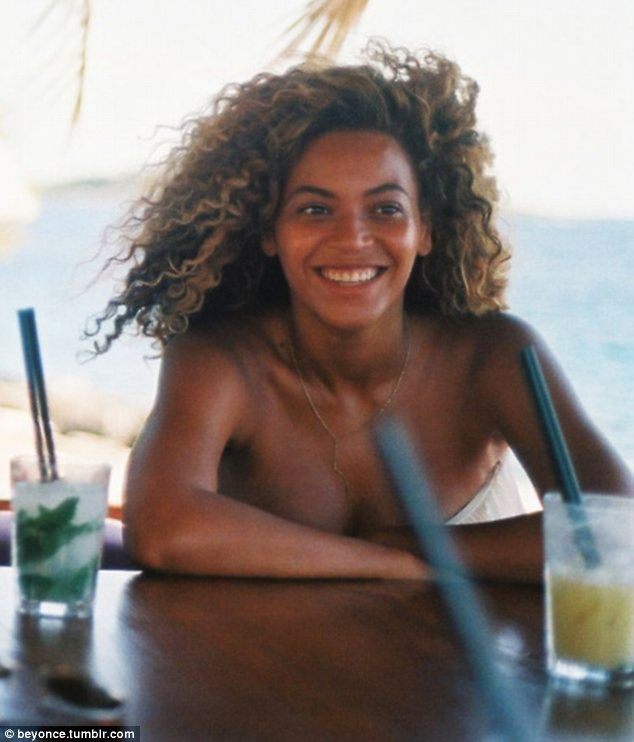 Relaxed: Beyoncé has shared holiday snaps in the series of images, which make up just one section of the expansive website