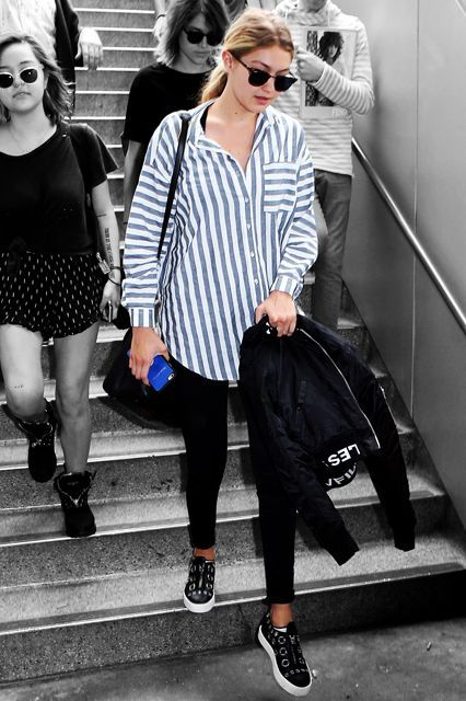 Update: Gigi Hadid was not wearing Joe Jonas' striped shirt for a cross-country flight to Los Angeles. She was wearing a boyfriend shirt from ASOS, with skinny jeans and kicked-up slip-on sneakers by Giuseppe Zanotti. #refinery29 http://www.refinery29.com/gigi-hadid-boyfriend-shirt-outfit#slide-1