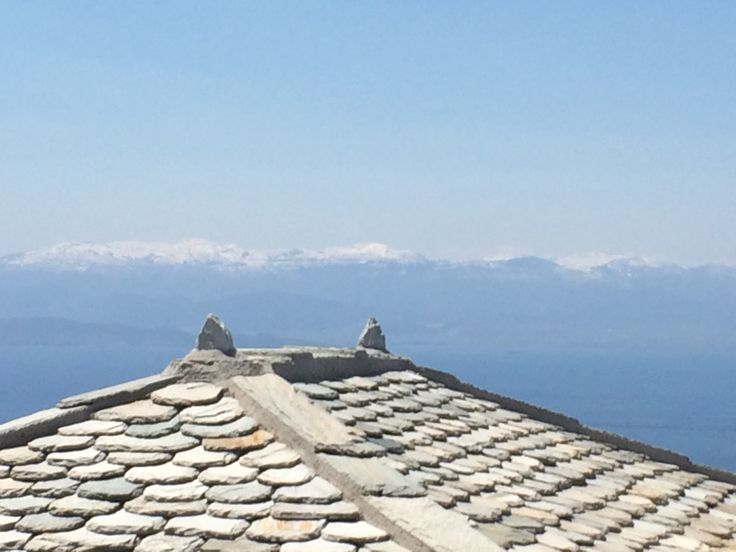 Roof detail with snowed peaks - Pelion - Greece