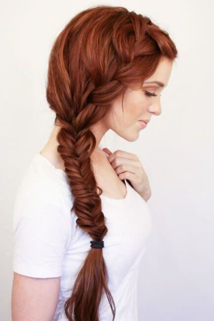 Beautiful woman with a long side braid