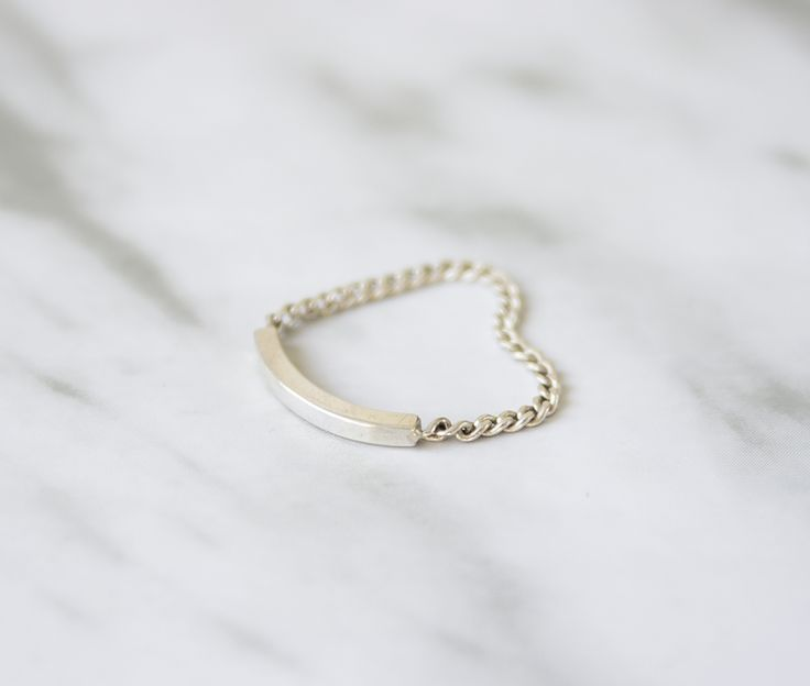 Bar and chain ring made in Sterling Silver from Hache Varela.