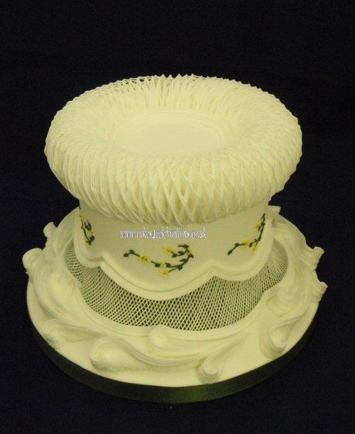 traditional royal iced cake - all work royal icing top edge decoration - custion work (created  by overpiping lines)