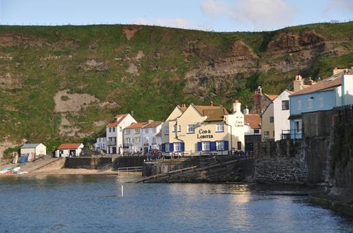 Staithes, England was the town that introduced explorer James Cook to the allure of the sea. Try the Cod and Lobster pub for people-watching and water views.