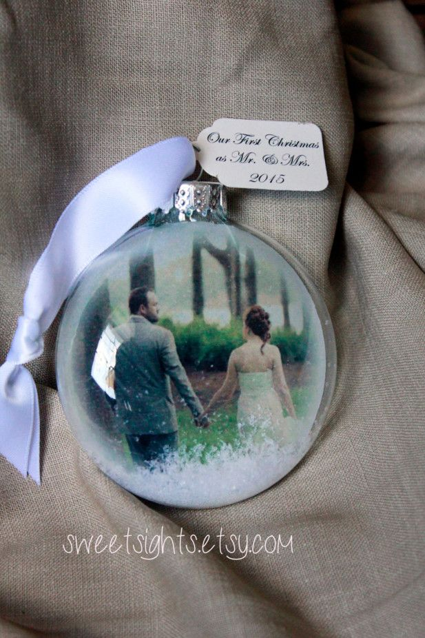 These handmade ornaments are created with your favorite image and include a message of your choice. We think this would make such a lovely gift for the newlyweds in your life!
