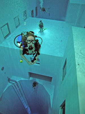 Situated in Belgium, the Nemo 33 pool, is the world's deepest recreational diving pool. It has a depth of just over 100 ft (approx 33 m). The pool was designed by a Belgian diving expert, John Beernaerts and is used for recreation, scuba diving practice and instruction and by film-makers and scientists.