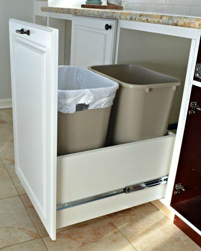 A genius kitchen storage solution...hidden trash/recycle bins with full extension drawer slides | http://chatfieldcourt.com