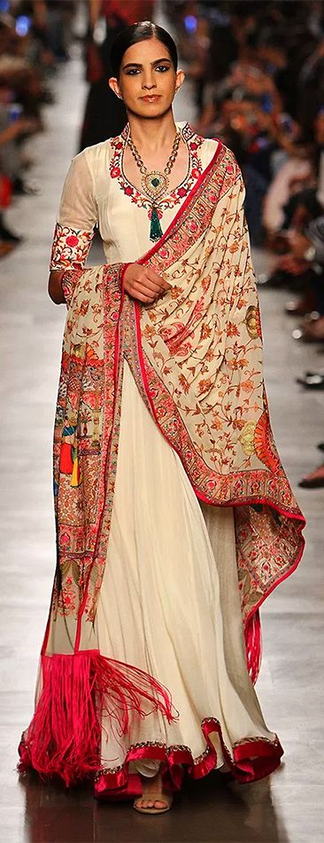 A model displays a designer saree lehenga at one of the ICW events. (Image Source: Pinterest)